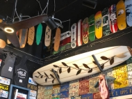 Old license plates, skateboards and surfboards adorn the interior walls